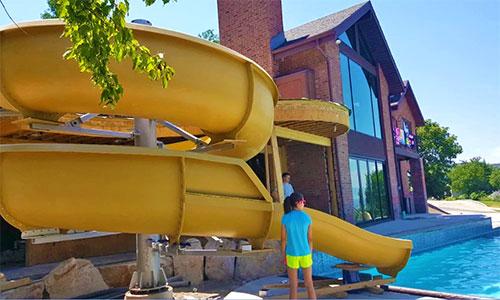 backyard-garden-pool-water-slide