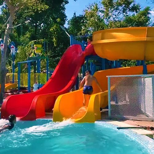backyard garden swimming pool water slide for family home